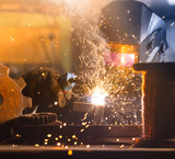 Welder working in workshop factory - 235657724