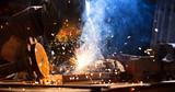 Welder working in workshop factory - 235658127
