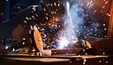 Welder working in workshop factory - 235658168