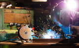 Welder working in workshop factory - 235658954