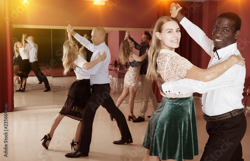 People learning to dance waltz