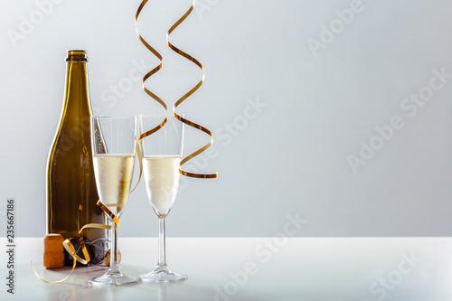 Leinwanddruck Bild New years eve celebration background with champagne