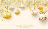 Yellow Christmas and New Year 2019 card with fir branches and shiny Christmas balls.