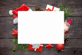 White paper card for New Year and Christmas greeting text. New Year's decoration on a wooden table. Top view.
