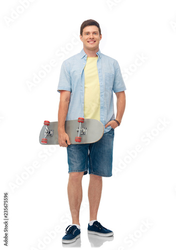 sport, leisure and skateboarding concept - smiling young man with skateboard over white background
