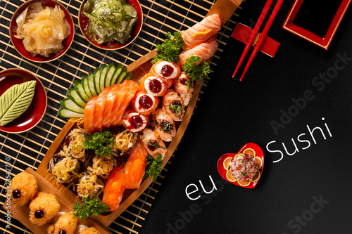 Japanese food combo in black background.itten I love Sushi in portuguese. Top view - 235677707