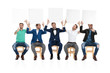 team of same man holding and presenting blank boards