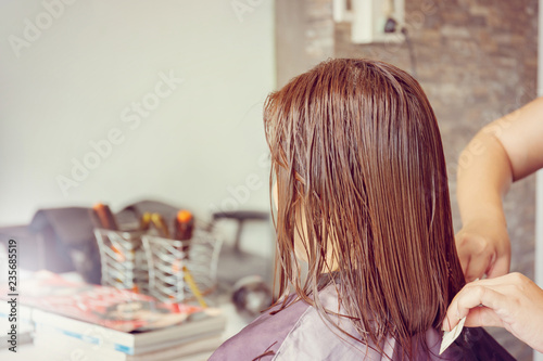 Close up of Women's haircut at the hair salon blurred background