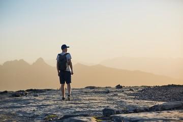 Tourist in mountain at sunset
