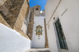 horizontal shot of alley in a side of Church of the Divine Savior, from XVI century, public monument in Andalusian village named Vejer de la Frontera in Cadiz (Andalusia, Spain, Europe) © Q