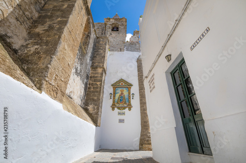 horizontal shot of alley in a side of Church of the Divine Savior, from XVI century, public monument in Andalusian village named Vejer de la Frontera in Cadiz (Andalusia, Spain, Europe)