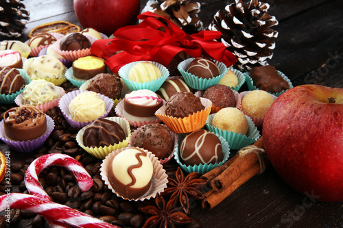fototapeta na ścianę a lot of variety chocolate pralines, belgian confectionery gourmet chocolate and christmas spices with apples
