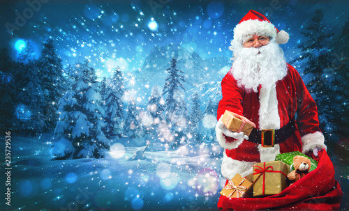 Santa Claus with a bag full of presents - 235729536