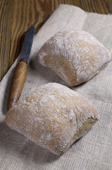 Two loaves of ciabatta bread and kitchen knife