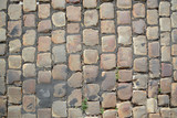 The texture of the pavement from the paving stones - 235752980