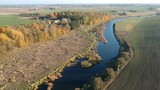 autumn river, fields with golden groves and houses, aerial view - 235753552