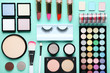Different makeup cosmetics on mint background