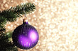 Leinwandbild Motiv Christmas tree with bauble toy on blurred background