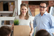 Leinwanddruck Bild - Smiling team leader, hr manager, friendly boss, executive introducing new just hired female employee to colleagues, happy woman holding box with belongings, first day at work concept