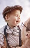 Beautiful portrait of a cute little boy hugging his dad - 235785797