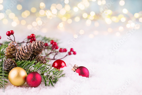 Leinwandbild Motiv Christmas decoration in snow landscape with Bokeh lights