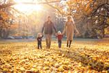 Joyful family enjoying great, autumnal weather - 235787741