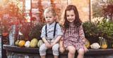 Portrait of little siblings on a farm - 235788185
