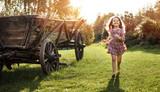Portrait of a little girl on a farm - 235788380