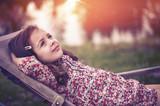 Closeup portrait of a relaxed, little girl - 235789133