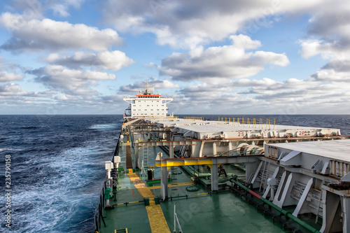 Cargo ship underway at sunny day