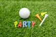 Golf Party invitation with golf ball and colourful tees on green grass