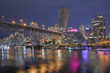 Downtown Vancouver and Granville Street bridge at night.