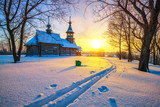 Small russian church in winter park at sunset - 235823309