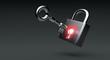 Glowing lock with key on dark background