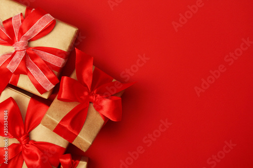 fototapeta na ścianę Wrapped presents with bright red background with copy space