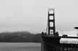 The golden gate bridge in the fog. San Francisco, CA.