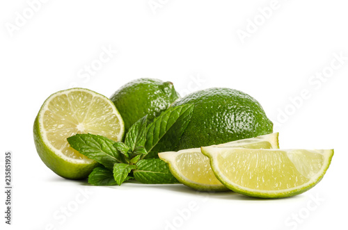 green mint, two limes and  two slices of a juicy lime isolated on white background - 235851935