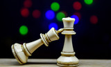 chess pieces king and queen on bokeh background,