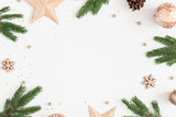 Christmas composition. Fir tree branches, golden decorations on pastel gray background. Christmas, winter, new year concept. Flat lay, top view, copy space