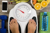 Healthy lifestyle concept with woman's feet having perfect weight on bathroom scale