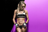 fitness woman on black and mauve background