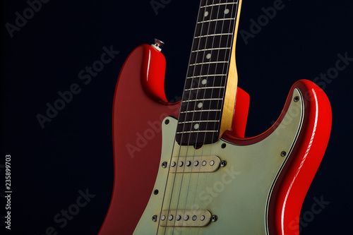 Detail of a red electric guitar - 235899703