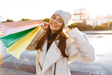 Cheerful young woman dressed in autumn coat and hat © Drobot Dean
