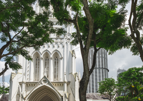 St Andrew's Cathedral is seen among tropical trees, Singapore. St Andrew's Cathedral is one of the famous tourist attraction in Singapore.