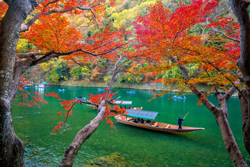 Colorful Arashiyama in autumn season along the river in Kyoto