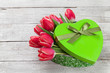 Red tulip flowers and heart gift box