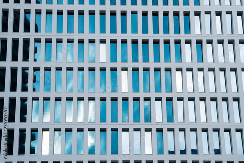 Office building windows background. Abstract geometrical pattern formed by architectural elements. Concrete modular structure. Contemporary building.