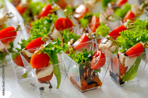salad with tomatoes and feta cheese - 235966707