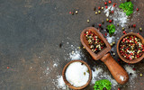 A variety of spices on a concrete background. Salt. Pepper. Top view - 235985129