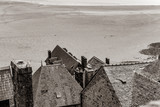 photo of beautiful roofs of wonderful buildings on the wonderful sea background . Image in black and white color style